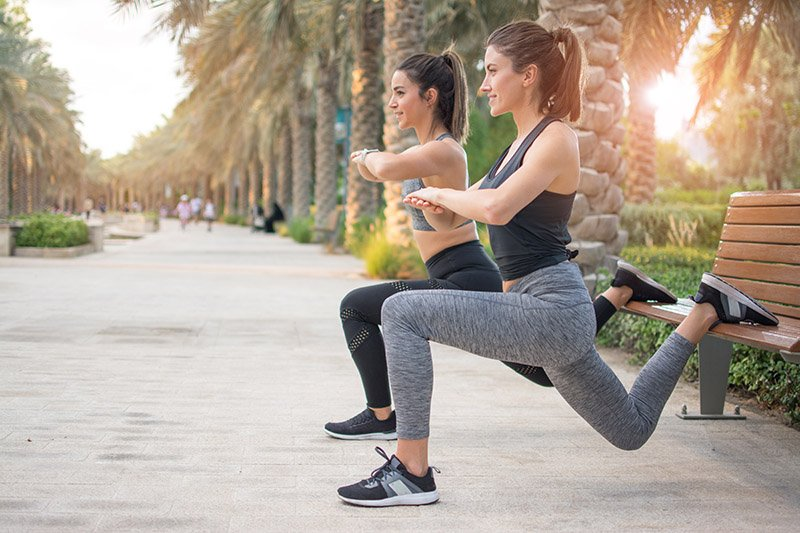 Two females training outdoors for progression